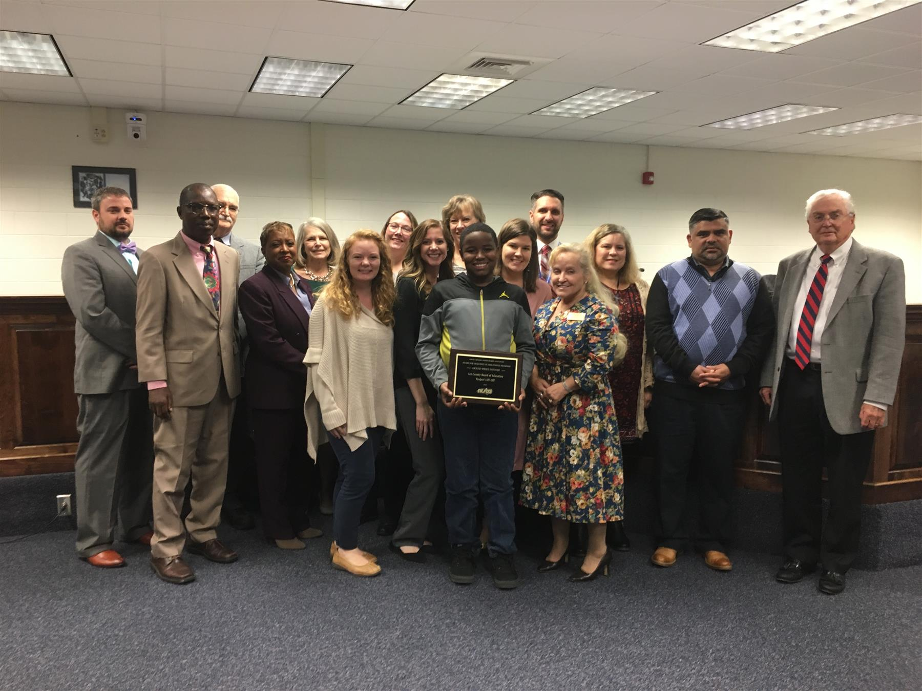 Dr. Johnnye Waller and her support staff receiving an award, with the Lee County Board of Education.