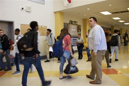 Dr. Dossenbach makes sure he's out in the halls during passing time.