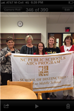 teachers holding banner